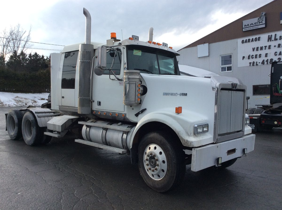 TRACTOR TRACTOR SMALL BUDGET, IDEAL FOR SEVERE APPLICATION ---  2009 WESTERN STAR 4900FA - #Stock: M2253 - Mileage: 1,200,582 km - Front axle: 12,000 lbs - Rear axle: 46,000 lbs - Differential: Meritor RT-46-160P - 46,000 lbs - Ratio: 4.10 - Wheels: aluminum - Tires: 11R24.5 - Engine: MBE4000 12.8 L - Power: 450 hp - Couple: 1,850 - Transmission: RTLO16918B - Wheelbase: 236 inches - Price on request only  Please note that we have two places where vehicles can be, either in Lévis or Saint-Georges. We suggest that you contact one of our experienced advisors to be informed of the geolocation of the vehicle before traveling.