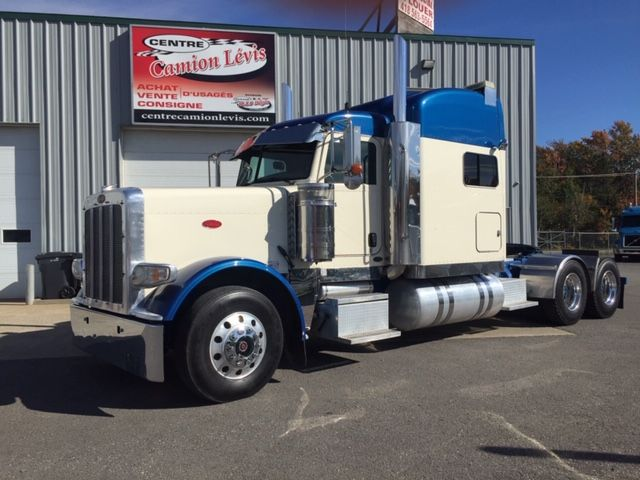 2012 PETERBILT 388 - Stock number: F1017 - Mileage: 1,360,510 km - Exterior color: White and blue - Interior color: brown - Doors: 2 doors - Engine: Cummins ISX - Power: 550 HP - Couple: 1,850 - Brakes: in the air - Axle spacing: 52 inches - Jacob engine brake: Yes - Traction: 3/4 lock - Cab to axle: 78 inches - Transmission: 18 speeds - Front axle: 12,000 lbs - Rear Axles (x2): 20,000 lbs - Differential: Dana Spicer D40-170 SUPER 40 - Ratio: 3.91 - Suspension: in the air of 40,000 lbs - Cabin: with berth - Front wheels: aluminum - AR wheels: aluminum - Front tires: 11R22.5 - Rear tires: 11R22.5 - Wheelbase: 262 inches - S.A.A.Q .: valid until November 2019 - Price on request only.  Please note that we have two places where vehicles can be, either in Lévis or Saint-Georges. We suggest that you contact one of our experienced advisors to be informed of the geolocation of the vehicle before traveling.